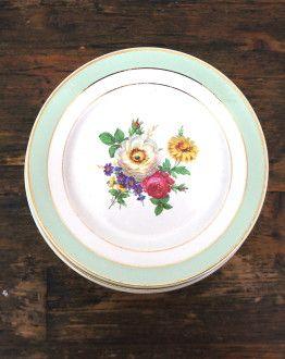Set van 10 groen gerande ontbijtbordjes met bloemmotief van Badonviller boven